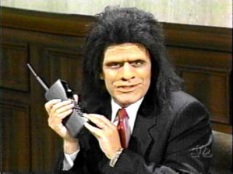 """caveman lawyer uses a phone - a great """"Saturday Night Live"""" skit"""
