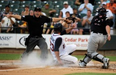 (8/10/2010) – James Brosher/AMERICAN-STATESMAN – Home base umpire Mike Lusky signals safe as Express first baseman Brian Bogusevic (23) slides into home plate, scoring Round Rock's first run in a game against Sacramento at Dell Diamond on Tuesday, Aug. 10, 2010. 0811express